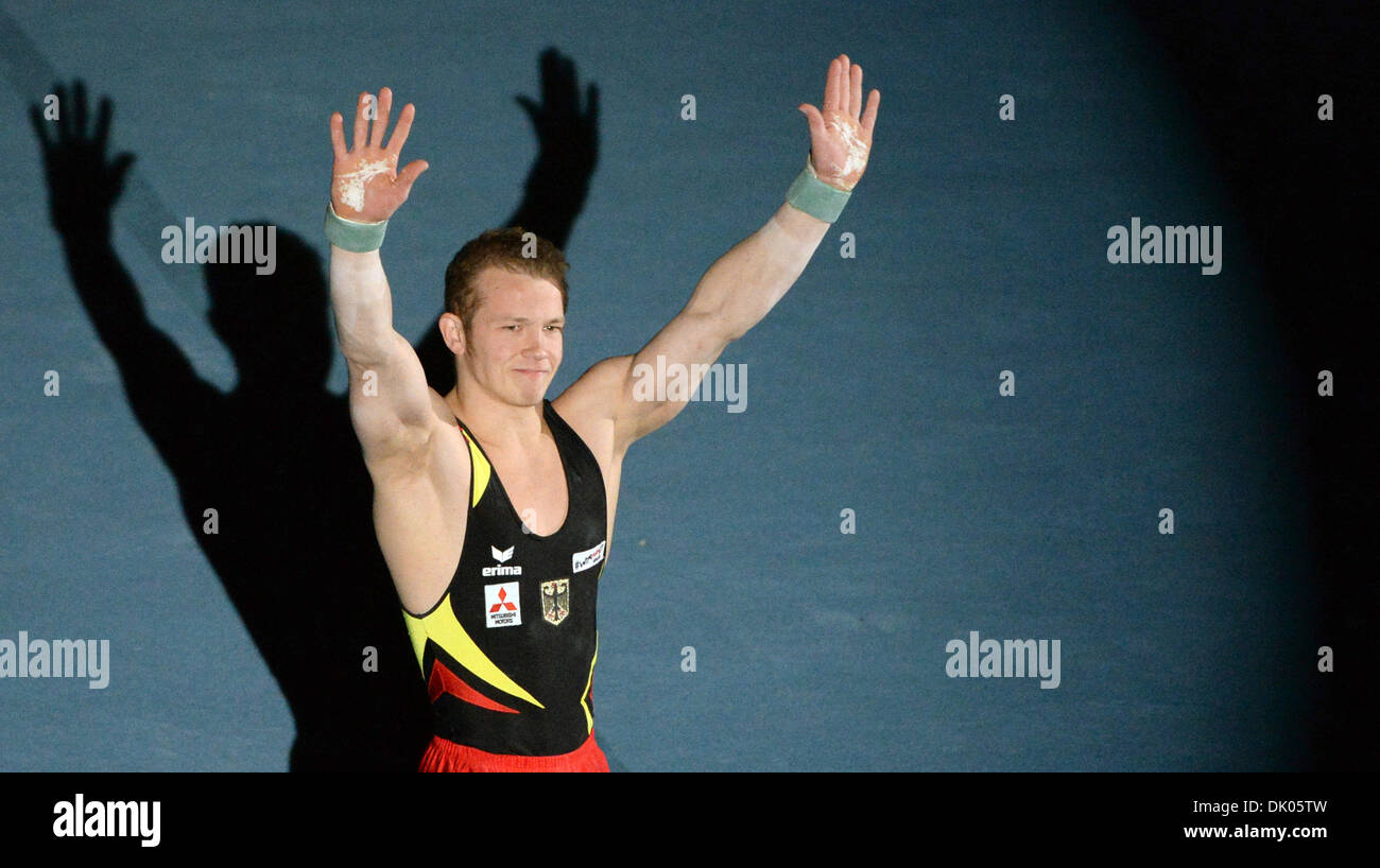 Stuttgart, Germany. 1st Dec 2013.Germany's Fabian Hambuechen greets the audience during the Gymnastics World Cup. Stock Photo