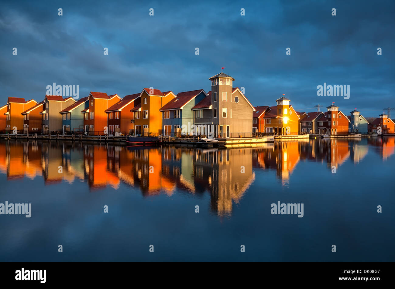 beautiful colorful buildings on water in gold sunshine, Reitdiephaven, Groningen, Netherlands Stock Photo
