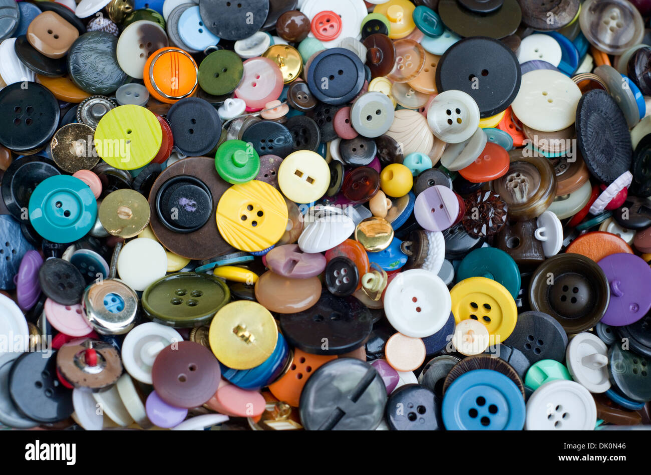 Close-up of a large collection of multi-coloured buttons - Stock Image