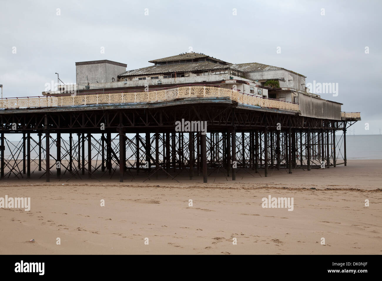 The old derelict Victoria Pier at Colwyn Bay on the North Wales coast opened in 1900 and closed to the public July 2008 - Stock Image