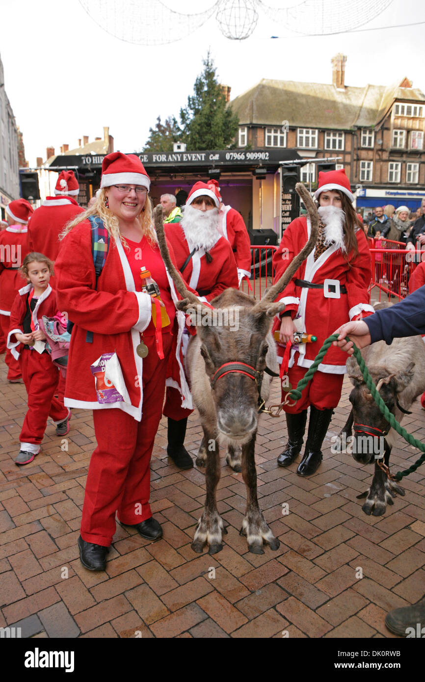 1st Dec 2013. Santa Dash runners pose with reindeer Bromley High Street  prior to switching the christmas lights on. Credit  Keith Larby Alamy Live  News e87935a3d