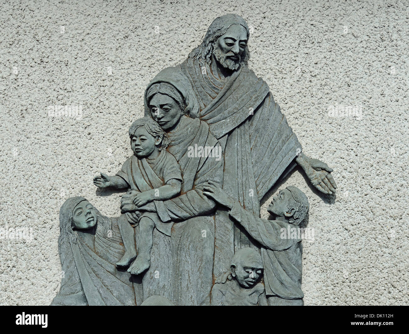 Christ with the needy. Sculpture. Church of Holy Trinity and Saint George, New Road, Kendal, Cumbria, England, United Kingdom. - Stock Image