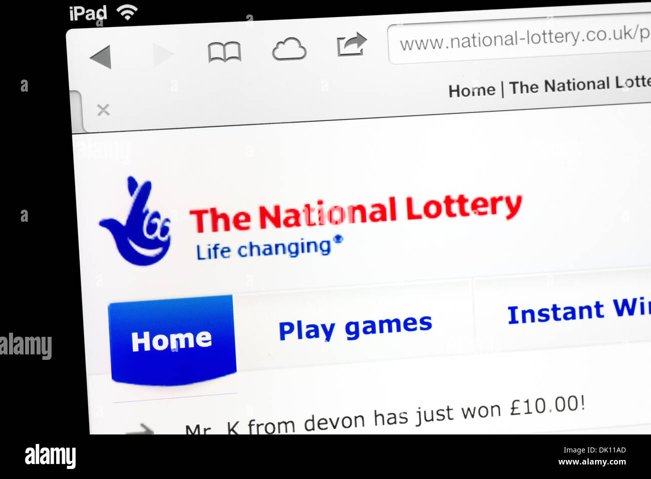 The UK National Lottery website on an iPad - Stock Image