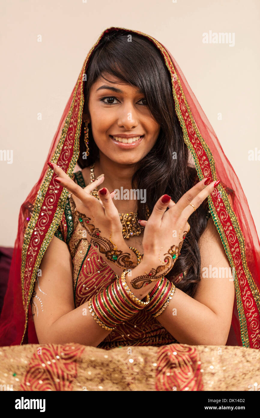 Portrait of an Indian woman with henna tattoos on her hands. - Stock Image