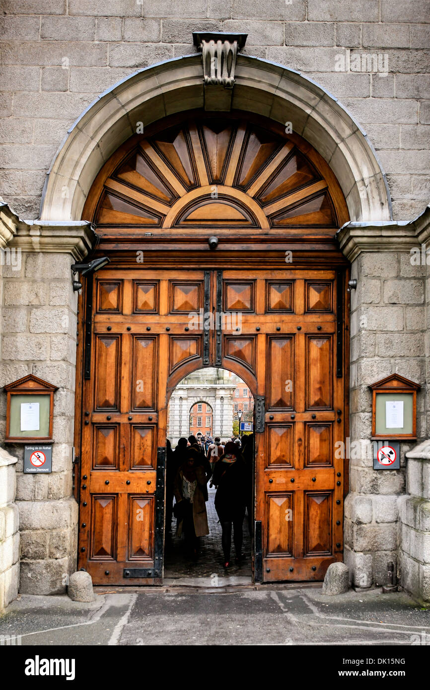 The wooden doors at the entrance to Trinity College Dubllin - Stock Image