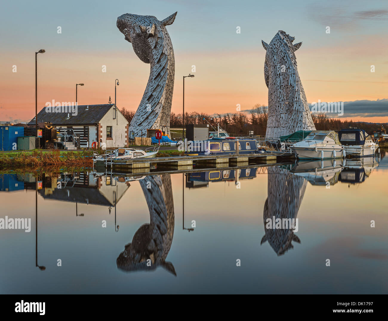 The Kelpies located within the Helix Park in Falkirk, Scotland on a calm sunny day - images taken during/just after sunset - Stock Image