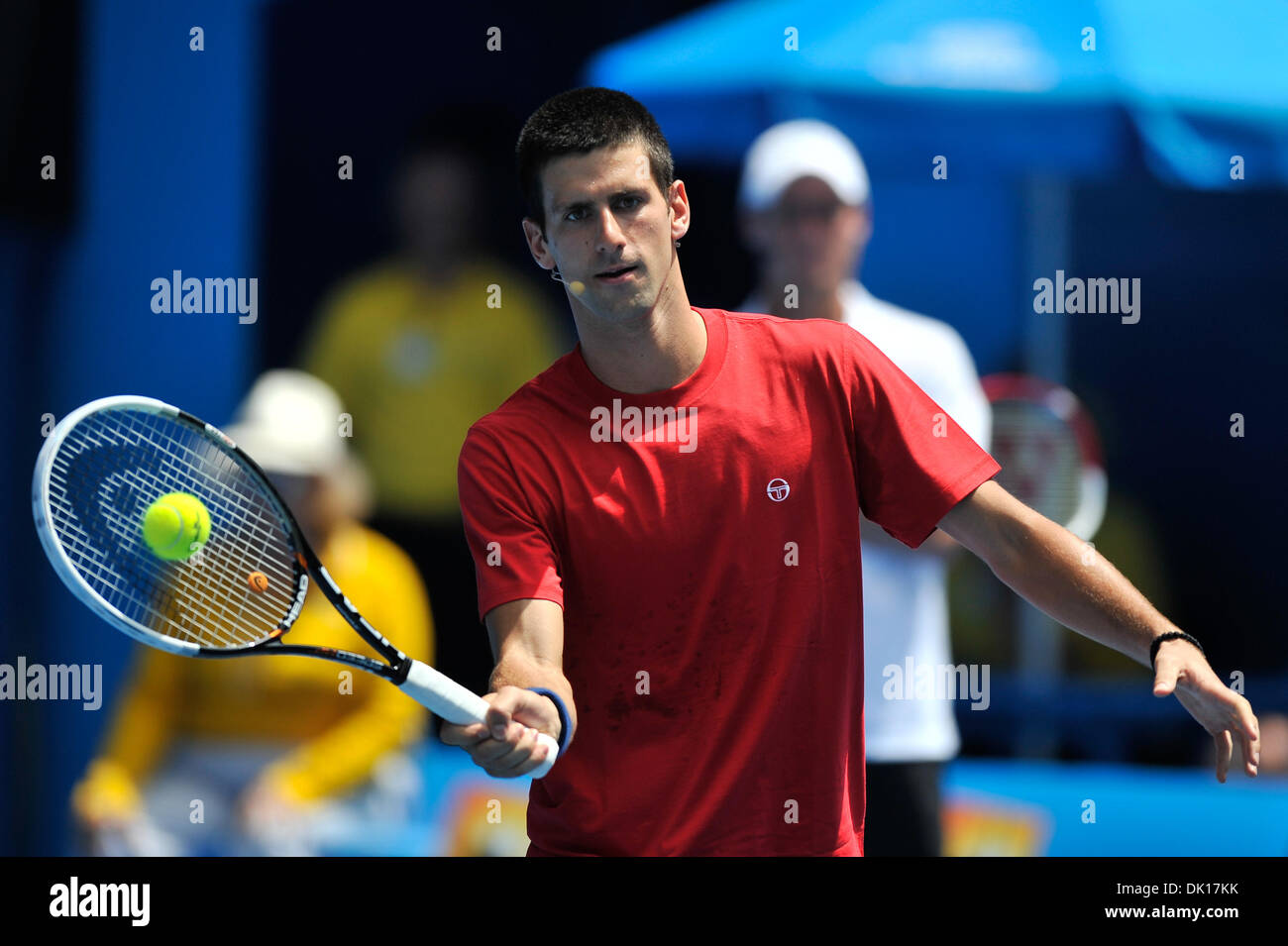 Jan. 16, 2011 - Melbourne, Victoria, Australia - Novak Djokovic hits a volley at the Rally For Relief charity exhibition match by top players of the 2011 Australian Open at Melbourne Park. (Credit Image: © Sydney Low/Southcreek Global/ZUMAPRESS.com) - Stock Image
