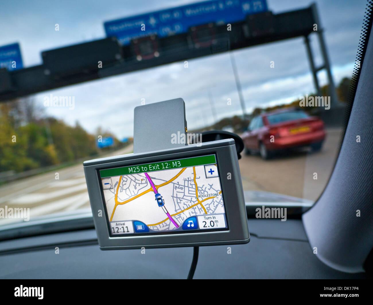 Satellite Navigation screen in-car display on M25 Orbital motorway Surrey UK - Stock Image