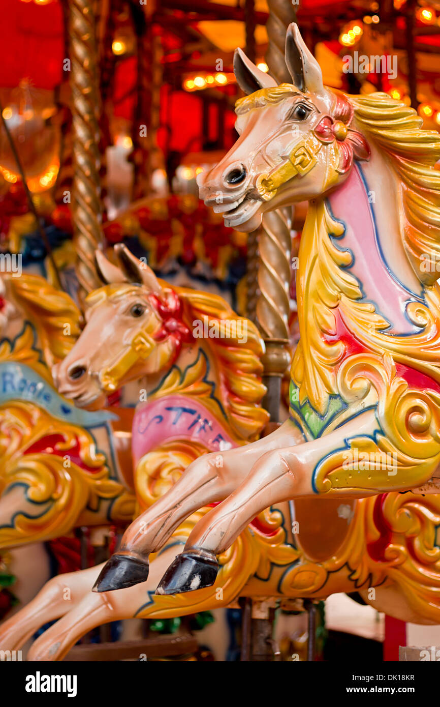 Traditional Carousel amusement ride found at old fashioned fairgrounds - Stock Image