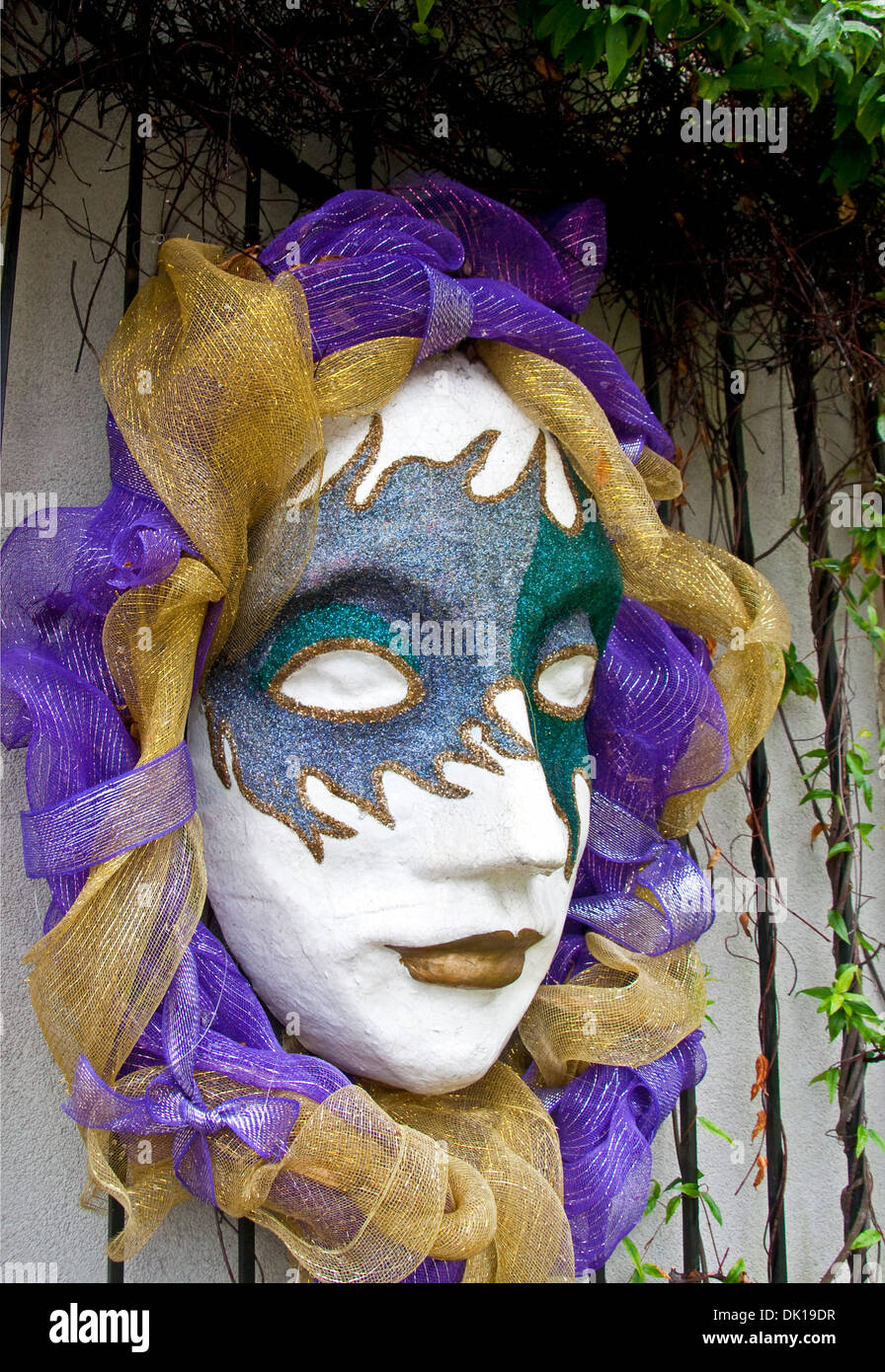 Mardi Gras mask at entrance of Mobile Carnival Museum. - Stock Image