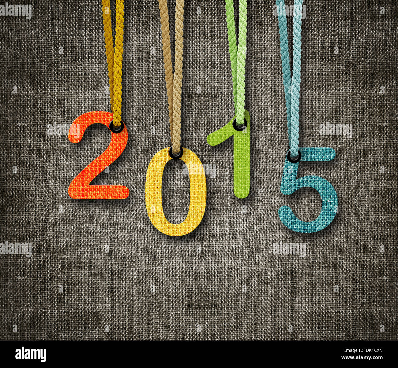 Happy New year 2015, numbers hunging by rope as puppeteer on sackcloth background, the same concept available for 2016. - Stock Image