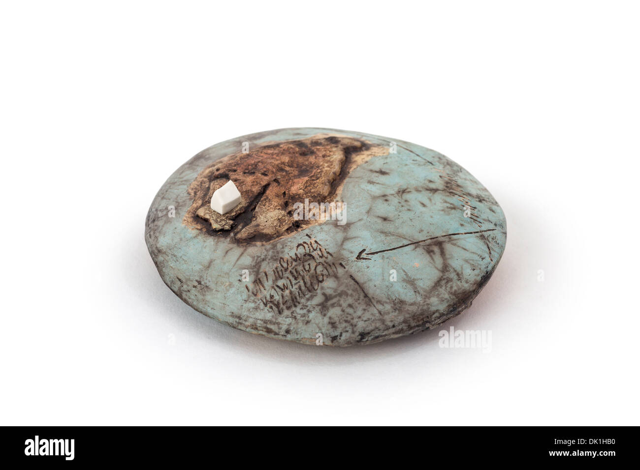 Modern sculpture by Jacques GALLON, ceramist.  Flat planet with white house. Stock Photo