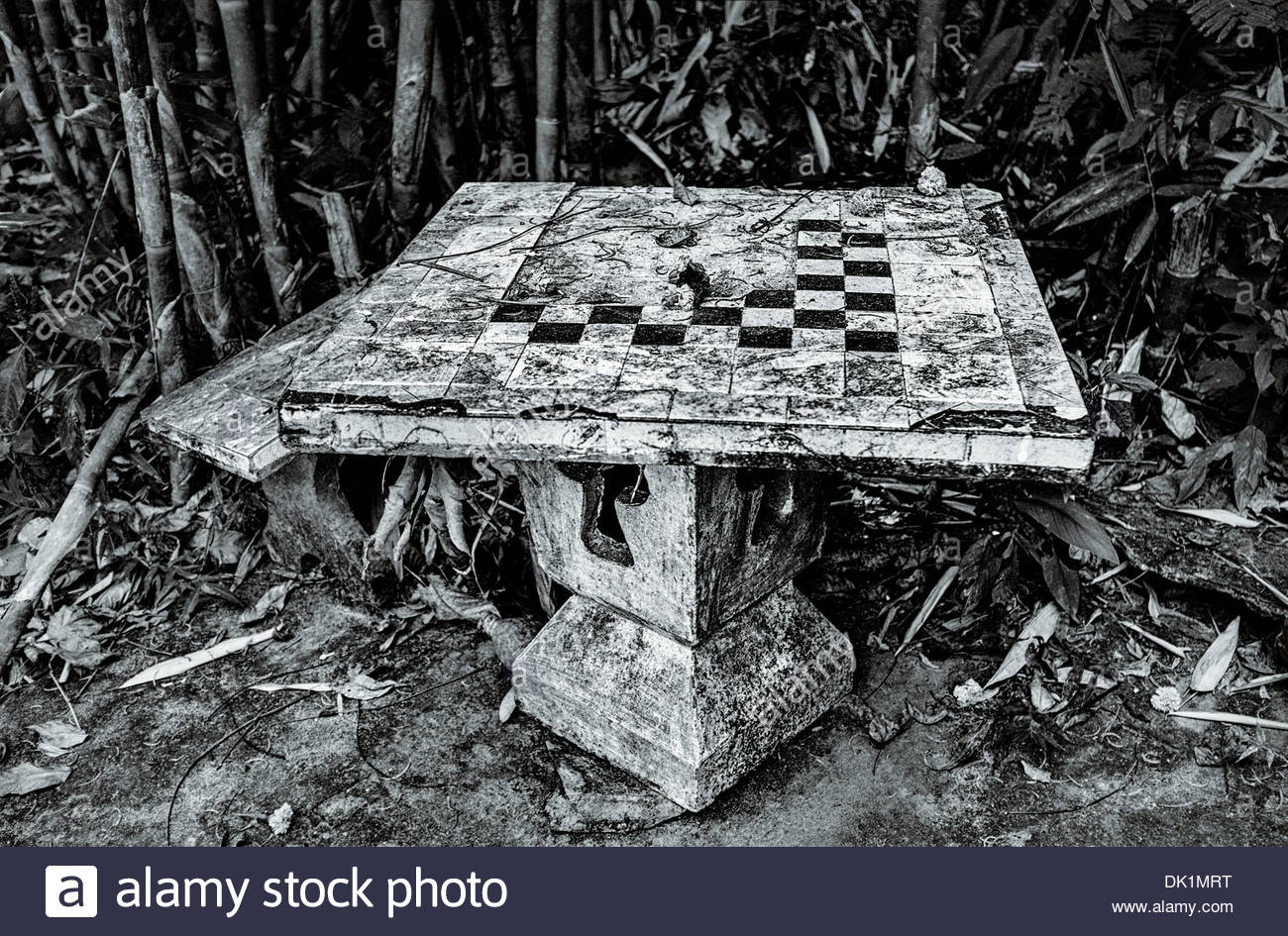 A broken table with fragments of a tiled chess board, Chiayaphum province, Isan, North East Thailand. - Stock Image
