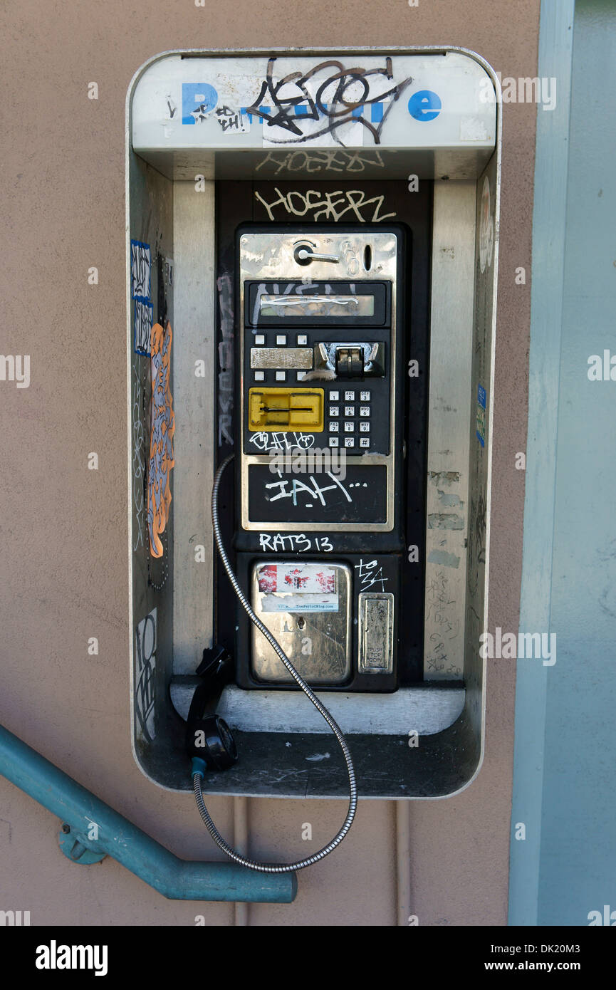 Defaced and broken payphone with graffiti, Vancouver, BC, Canada - Stock Image
