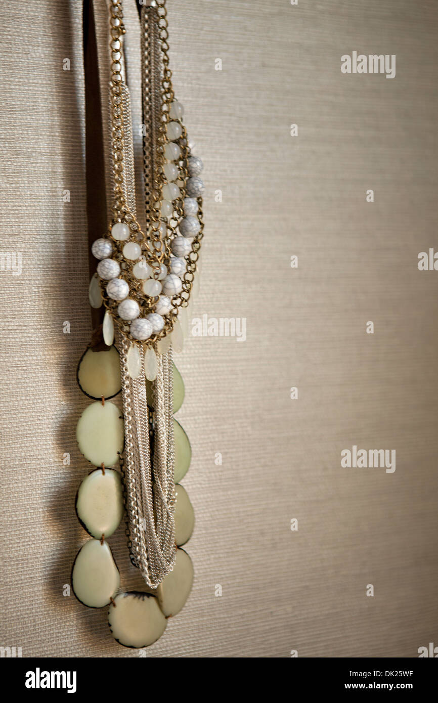 Close up of hanging variety of necklaces - Stock Image