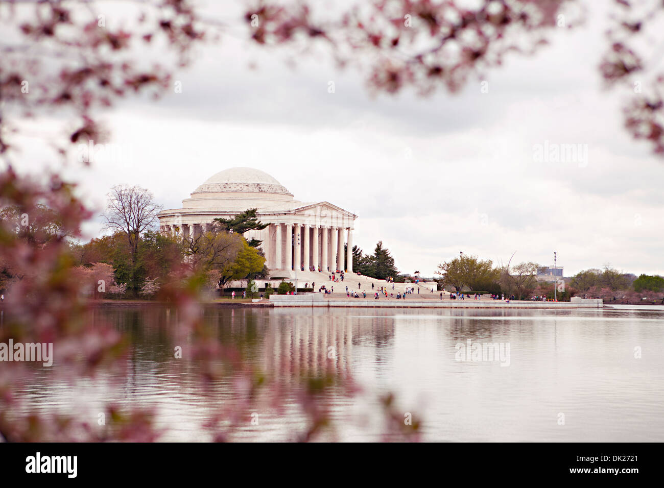Pink cherry blossoms framing view of \