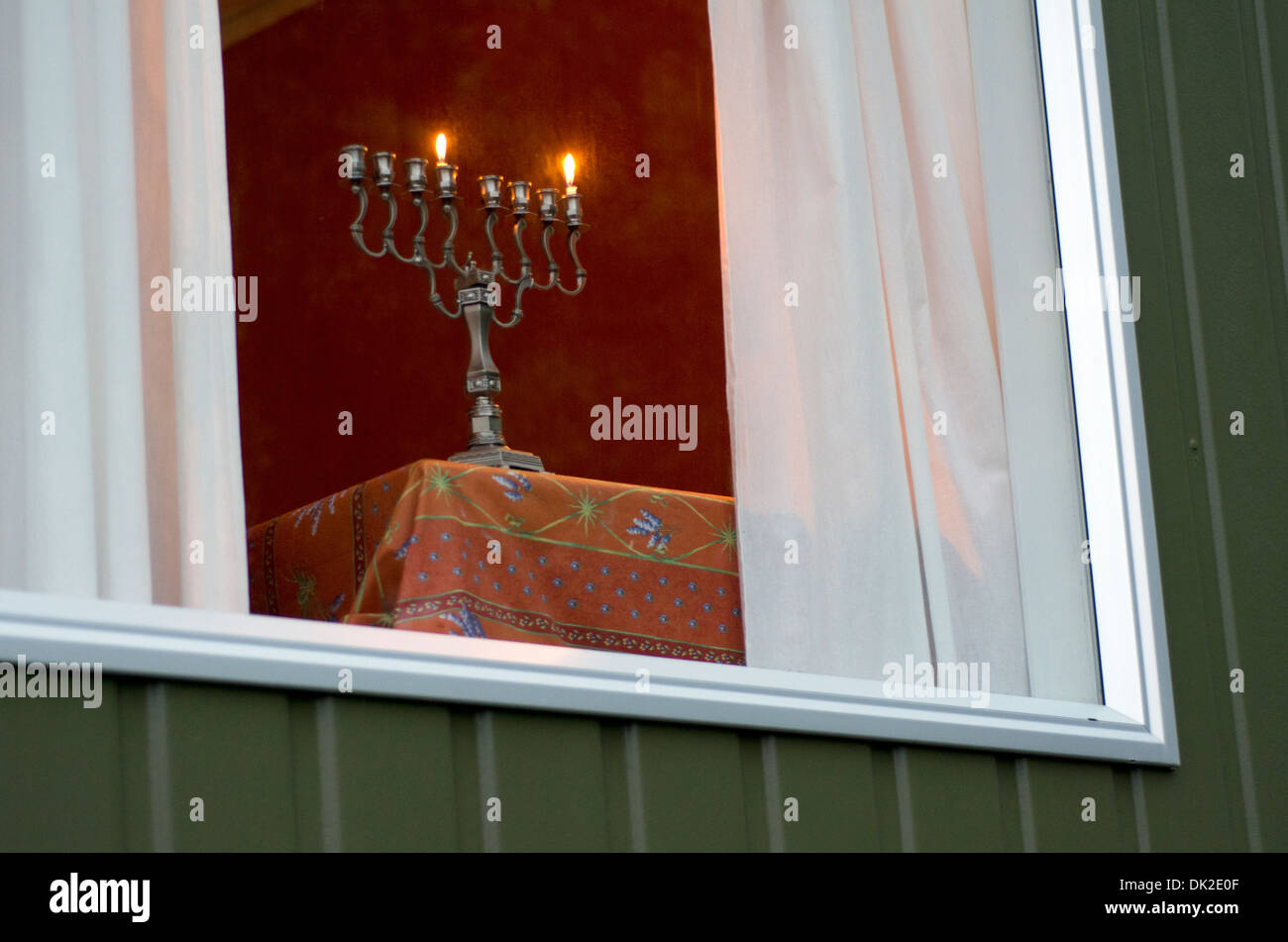 Hanukkah menorah with two burning candles on the fist day of Hanukkah Stock Photo