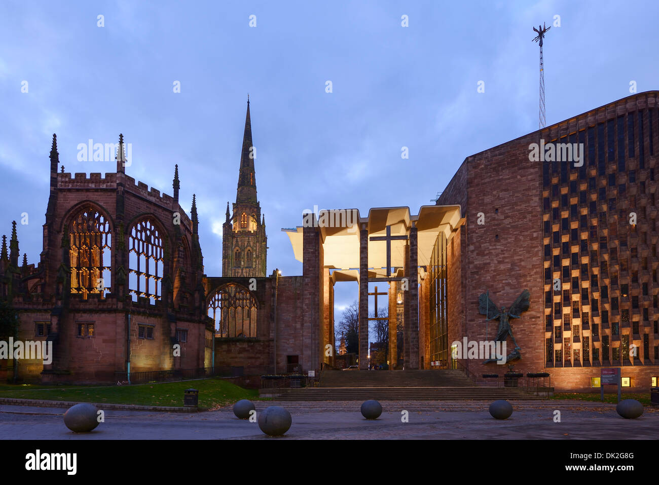 The old Coventry Cathedral alongside the New Cathedral at dusk - Stock Image