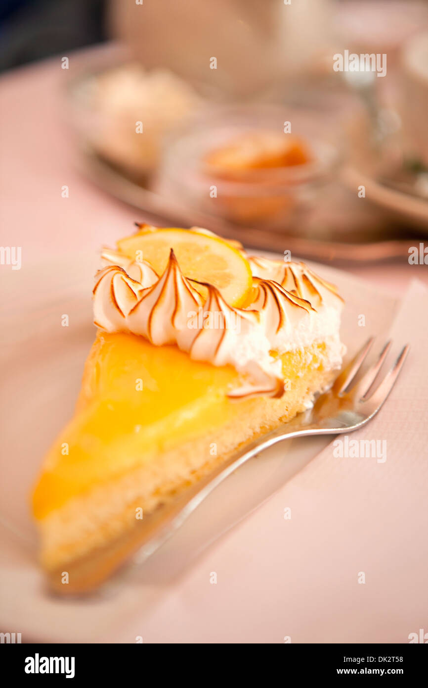 Close up of slice of lemon meringue pie - Stock Image