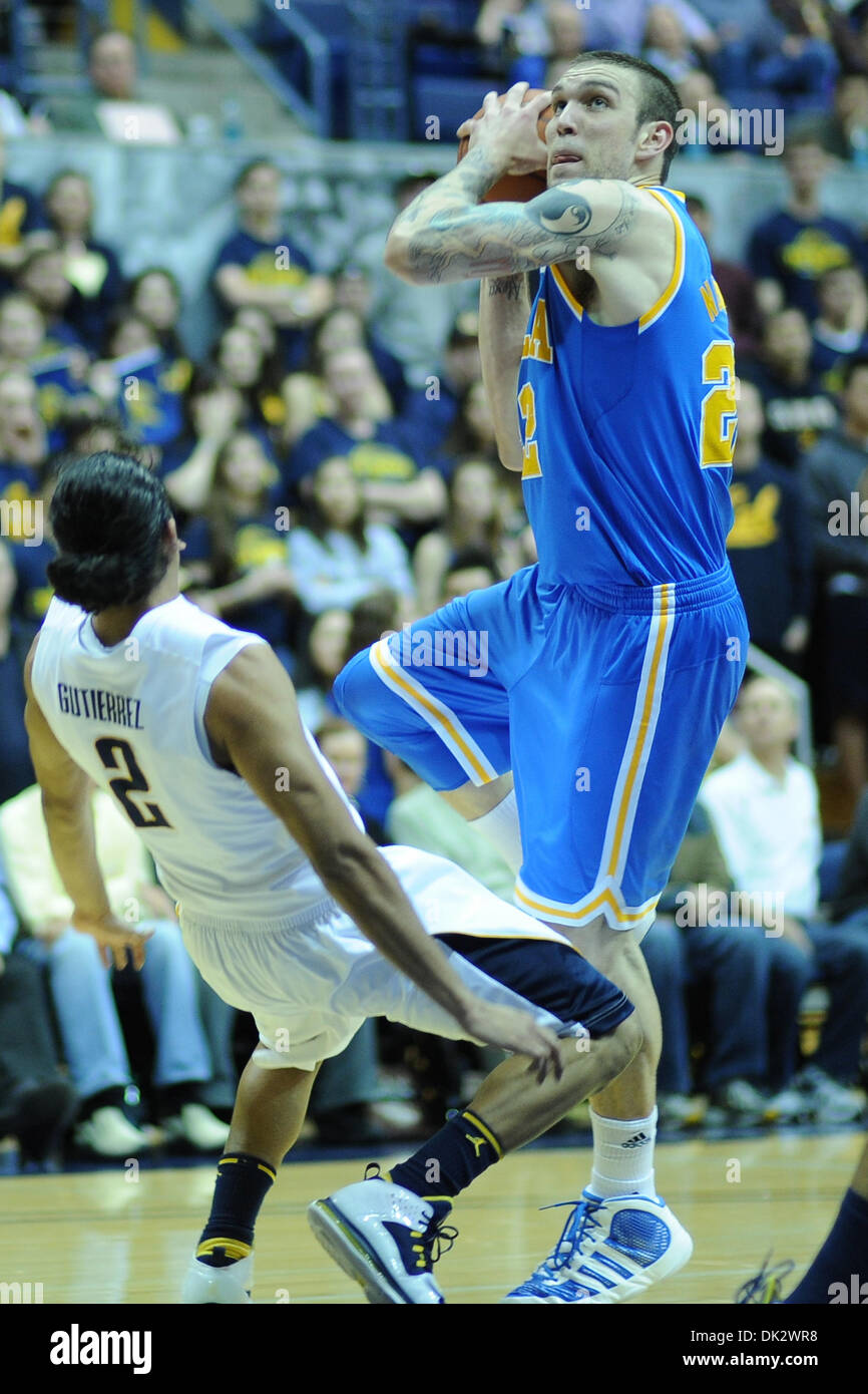 Feb. 20, 2011 - Berkeley, California, U.S - California Golden Bears guard Jorge Gutierrez (2) takes a charge from UCLA Bruins forward Reeves Nelson (22) during the NCAA basketball game between the UCLA Bruins and the California Golden Bears at Haas Pavilion.  Cal held off UCLA 76-72 in overtime. (Credit Image: © Matt Cohen/Southcreek Global/ZUMAPRESS.com) Stock Photo