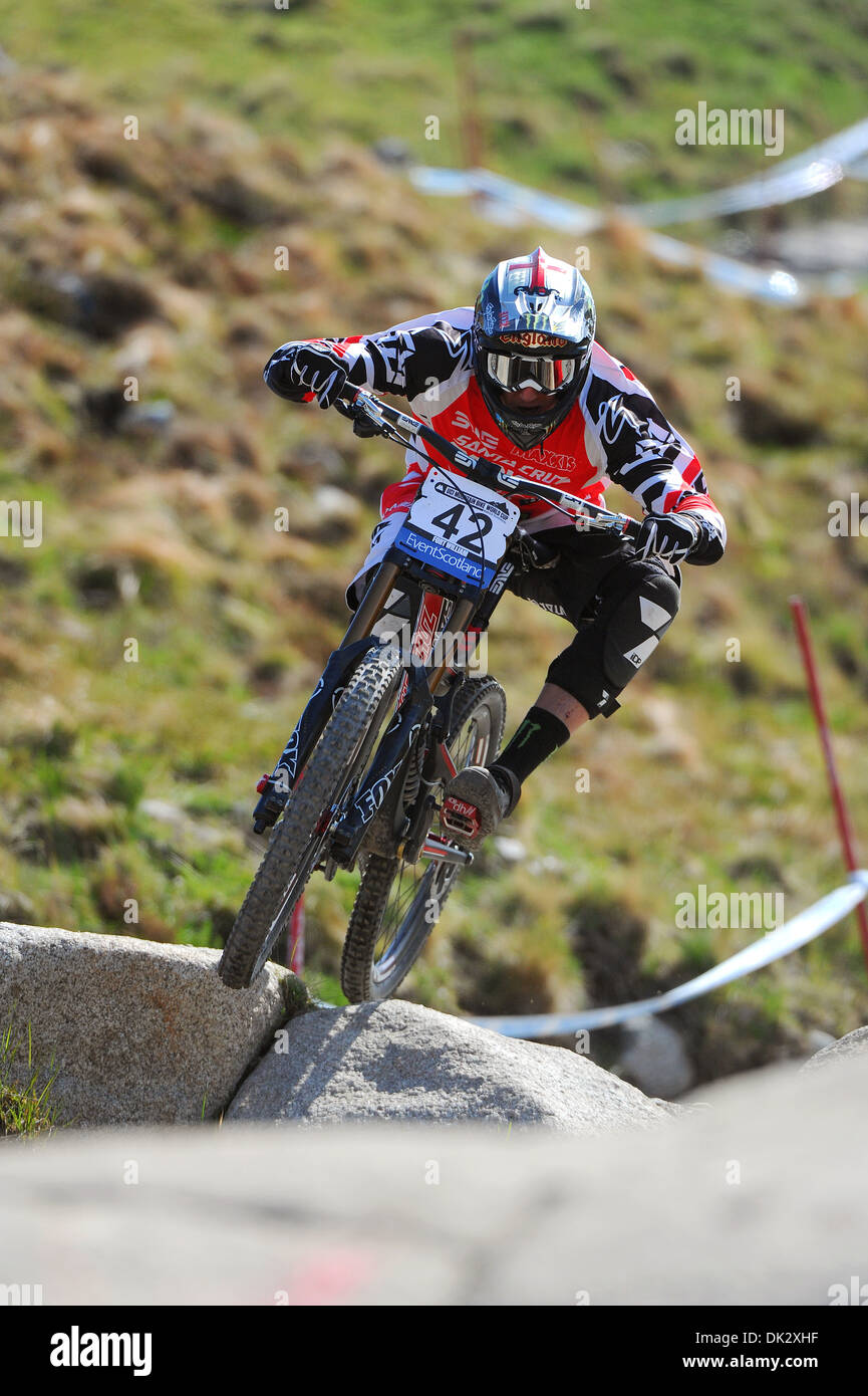Downhill mountain bike racer Steve Peat competes in the UCI Mountain Bike World Cup, Fort William in 2013. - Stock Image
