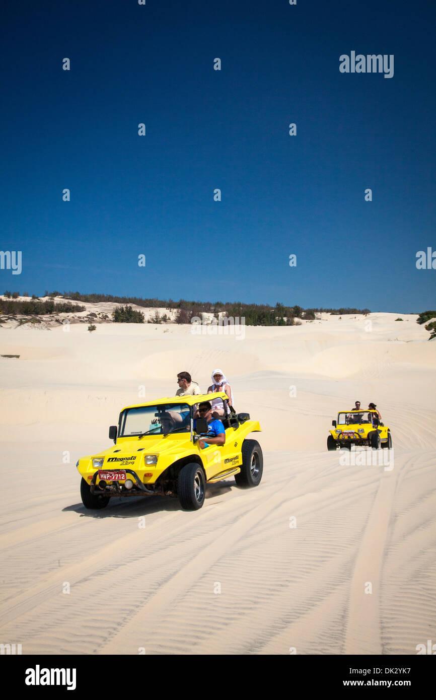 Dune buggies on the dunes, Cumbuco, Fortaleza district, Brazil. - Stock Image