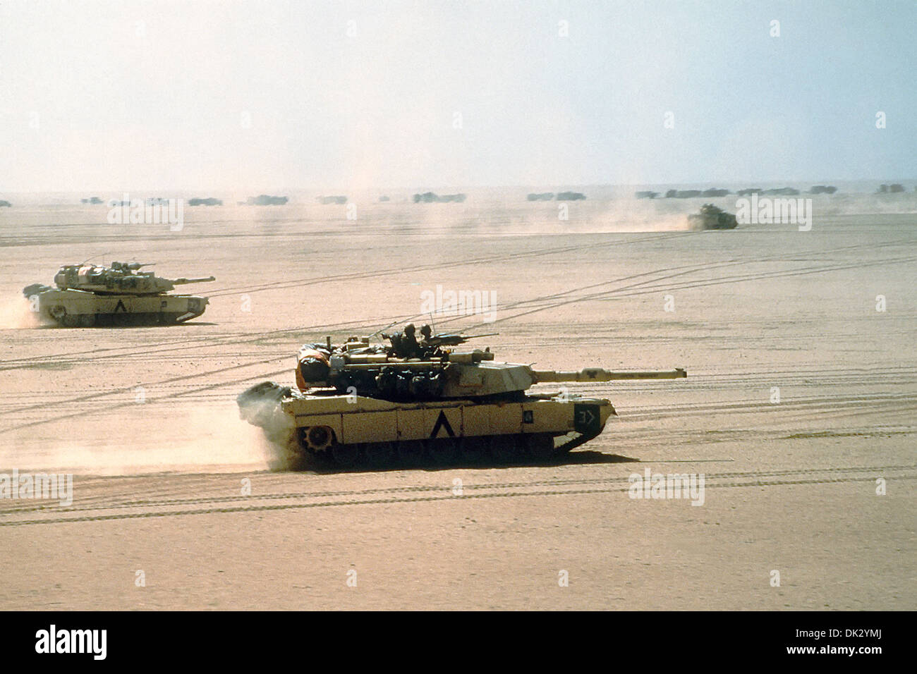 A US Army M-1A1 Abrams main battle tank from the 3rd Armored Division, moves across the desert into Kuwait during Operation Desert Storm February 15, 1991 in Kuwait. - Stock Image