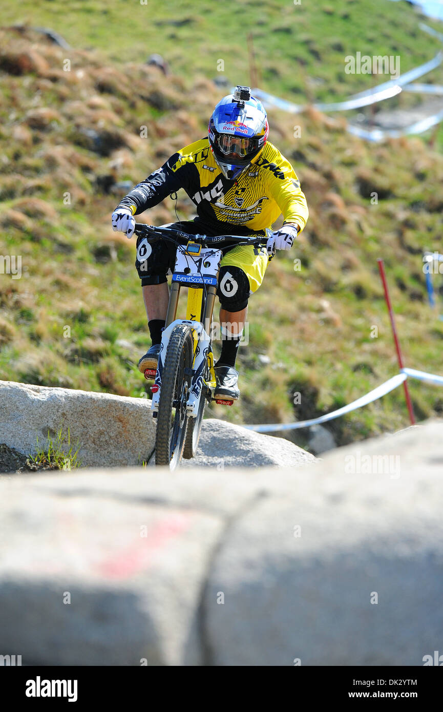 Downhill mountain bike racer Gee Atherton competes in the UCI Mountain Bike World Cup in Fort William, Scotland. - Stock Image