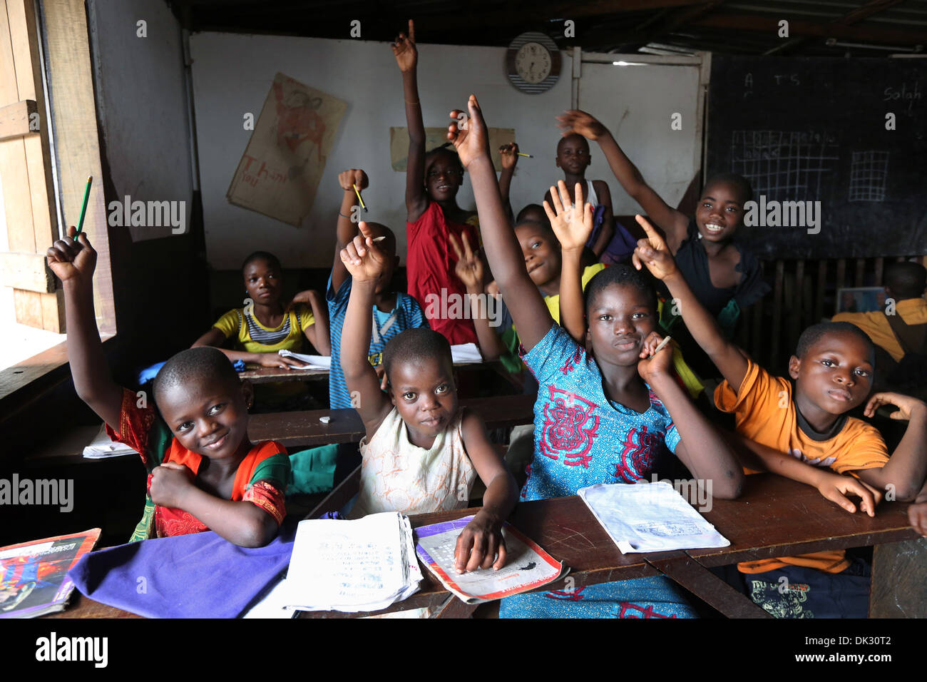 Children in a classroom of PEACE HOME, a voluntary school run by the catholic church. Township Agbogbloshie, Accra, West Africa - Stock Image