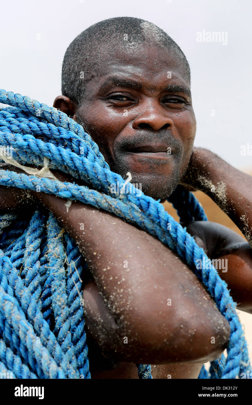 Portrait of a fisherman with a blue rope. Accra, Ghana, Africa - Stock Image