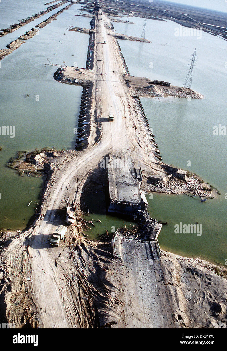 Aerial view of a demolished section of bridge across the Euphrates River after being hit in an Allied bombing attack during Operation Desert Storm March 4, 1991in Balad, Iraq. - Stock Image