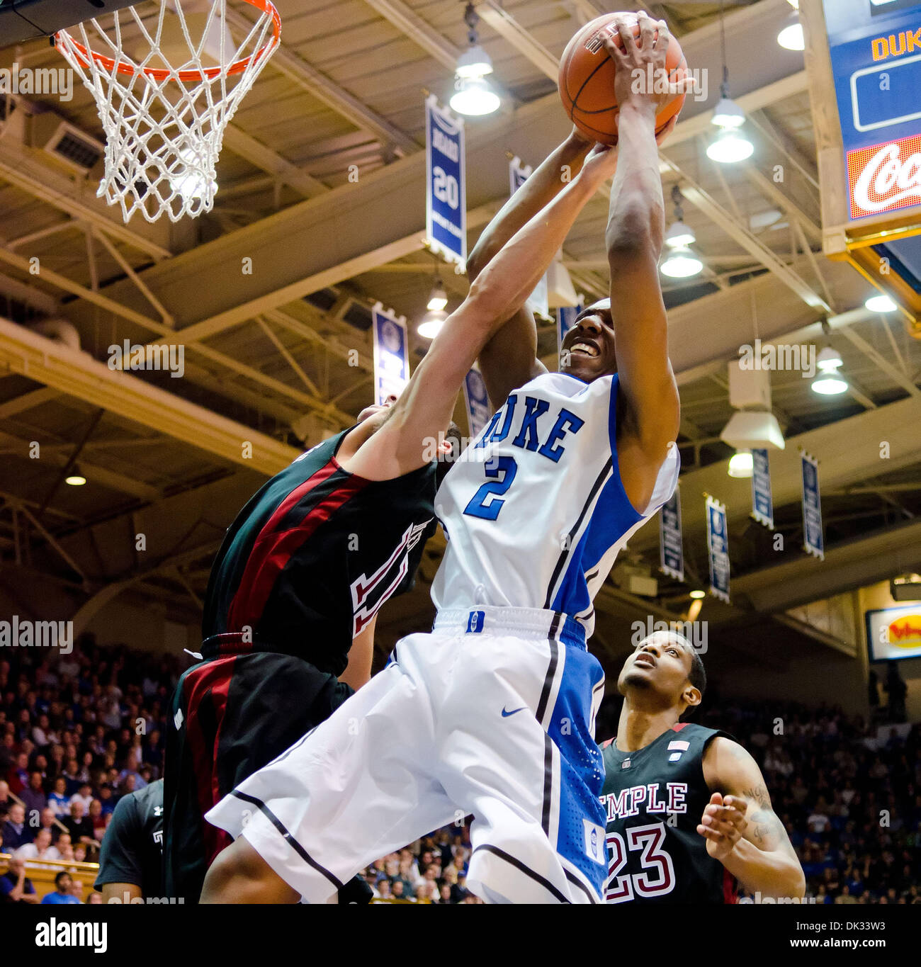 Feb. 23, 2011 - Durham, North Carolina, U.S - Duke Blue Devils guard Nolan Smith (2) and Temple Owls guard T.J. DiLeo (11) battle for the ball. Duke beats Temple 78-61 at Cameron Indoor Stadium Durham NC (Credit Image: © Mark Abbott/Southcreek Global/ZUMAPRESS.com) - Stock Image