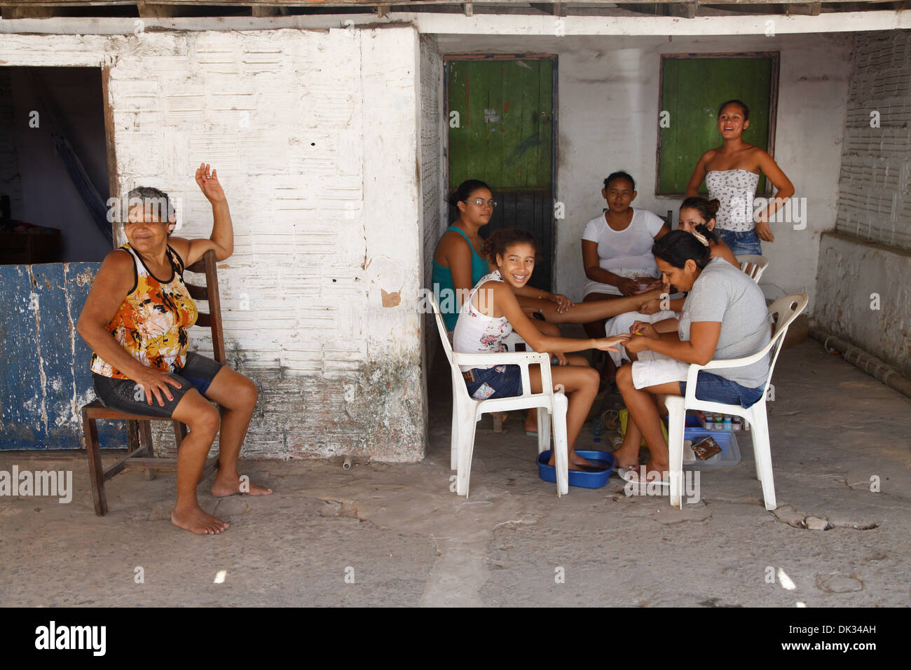 Local women doing their nails in the house shade, Cumbuco, Fortaleza district, Brazil. - Stock Image