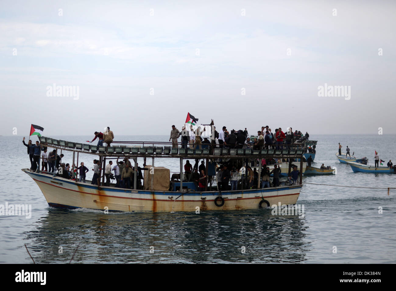 Gaza. 2nd Dec, 2013. Palestinians sail their boats as part of a convoy which launched at the initiative of the 'Intifada Youth Coalition' to break the naval blockade of Gaza as a protest against the Israeli siege in Gaza port on Dec. 2, 2013. Credit: Xinhua/Wissam Nassar/Alamy Live News - Stock Image