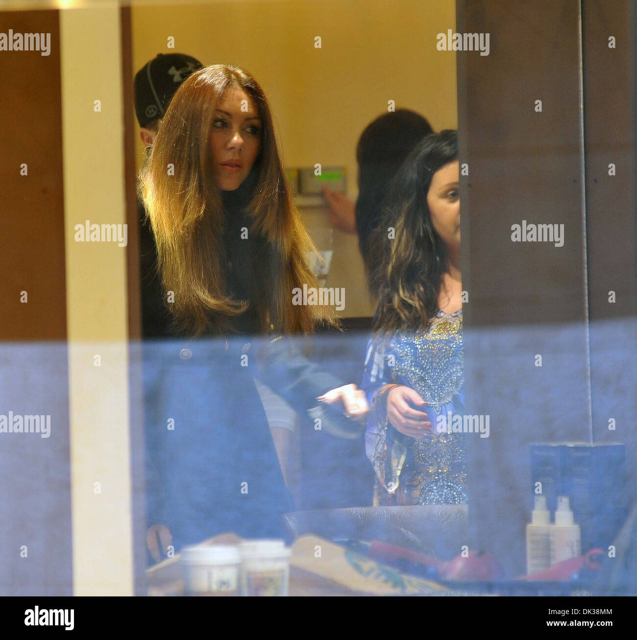 Singer Michelle Heaton seen accompanied by her husband Hugh Hanley at 'Salon Caramelle' getting her hair done by stylist Ceira - Stock Image