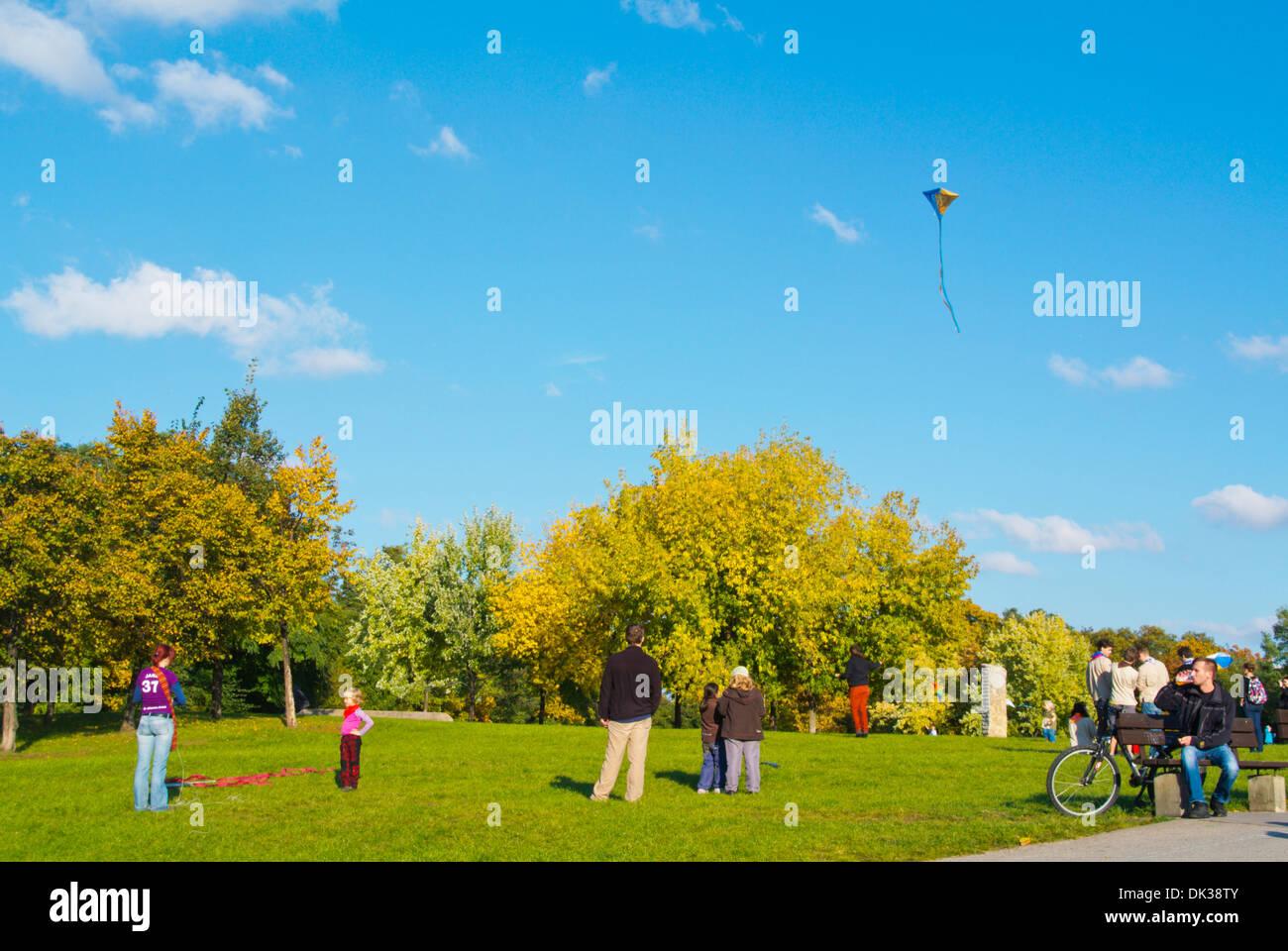 People flying kites Parukarka park Zizkov district Prague Czech Republic Europe - Stock Image