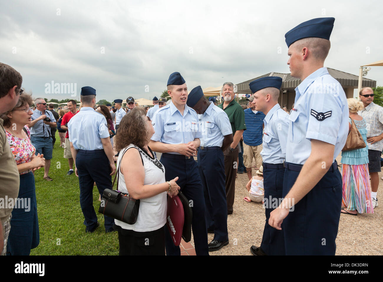 New airmen visiting with parents after United States Air Force basic