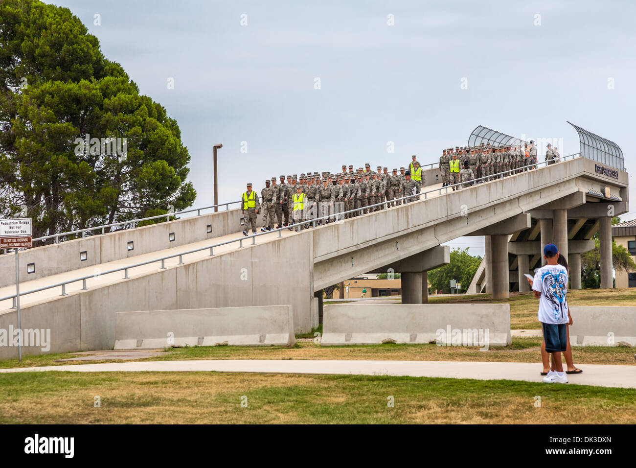Flights of airmen marching down bridge ramp during United States Air Force basic training in San Antonio, Texas - Stock Image