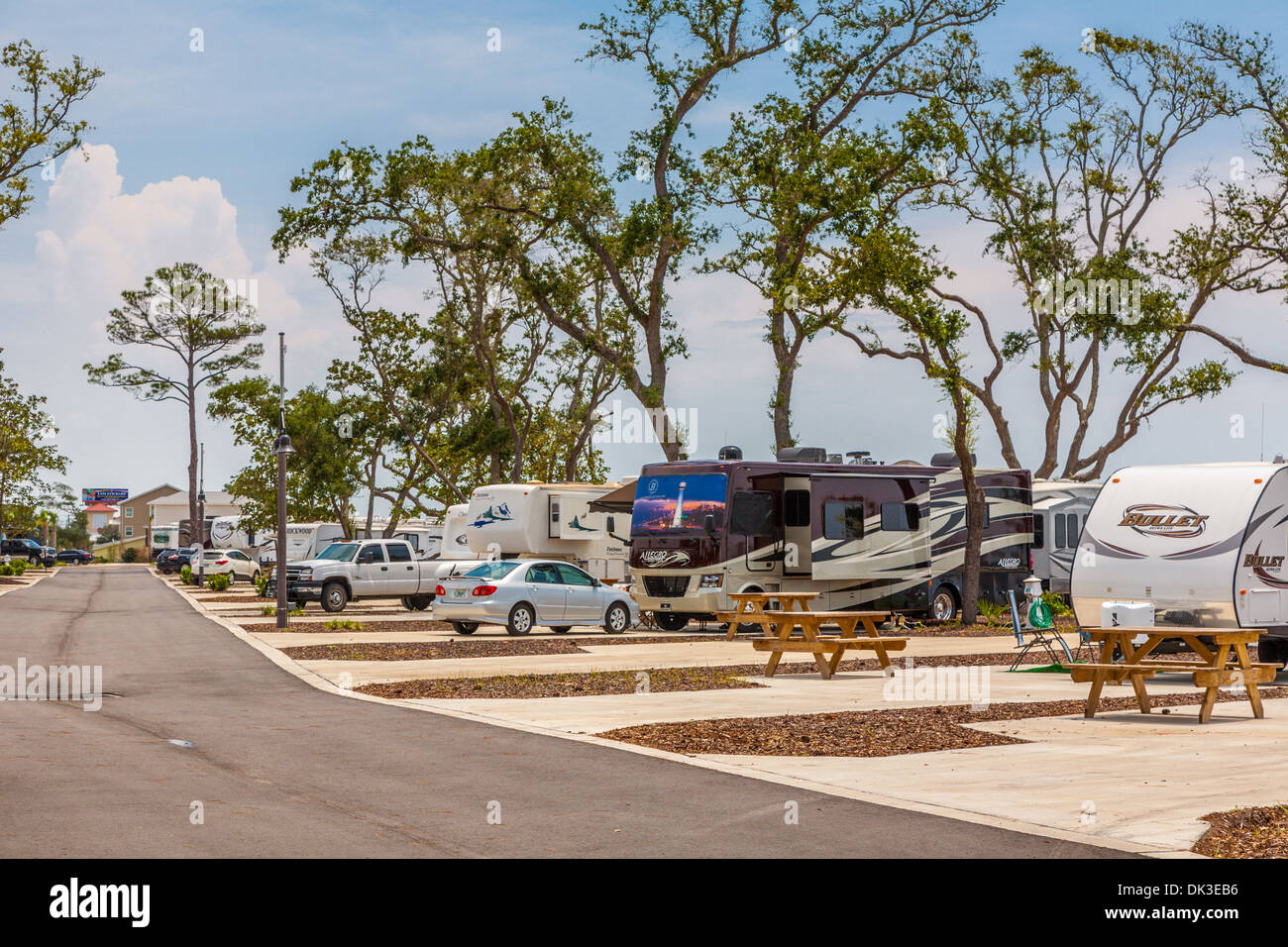 Motorhomes and travel trailers at St. Rosa RV Resort campground in Navarre, Florida - Stock Image