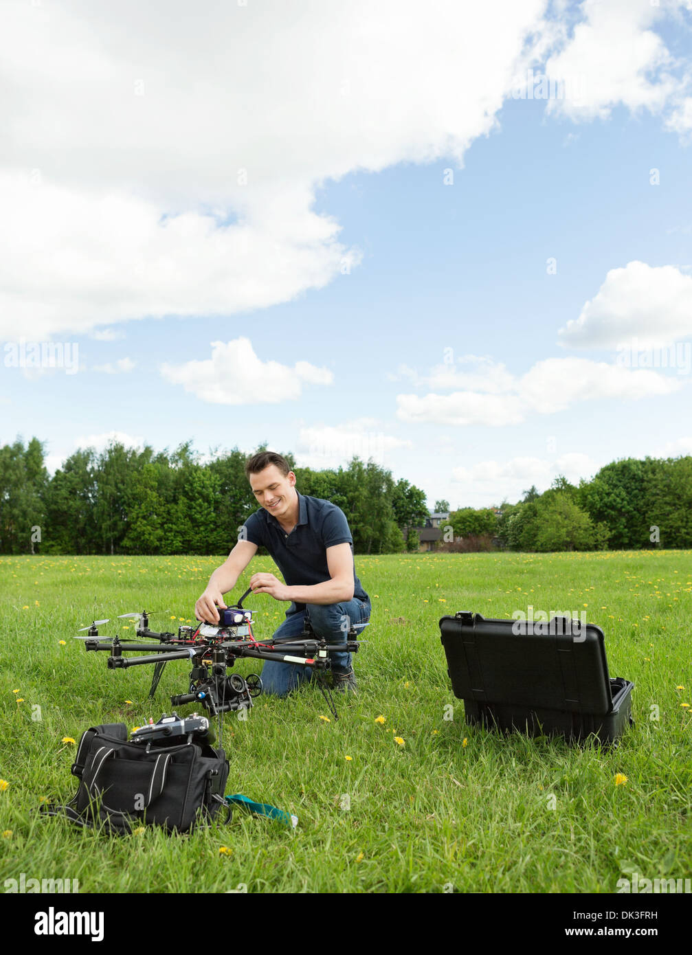 Technician Preparing Multirotor Helicopter - Stock Image