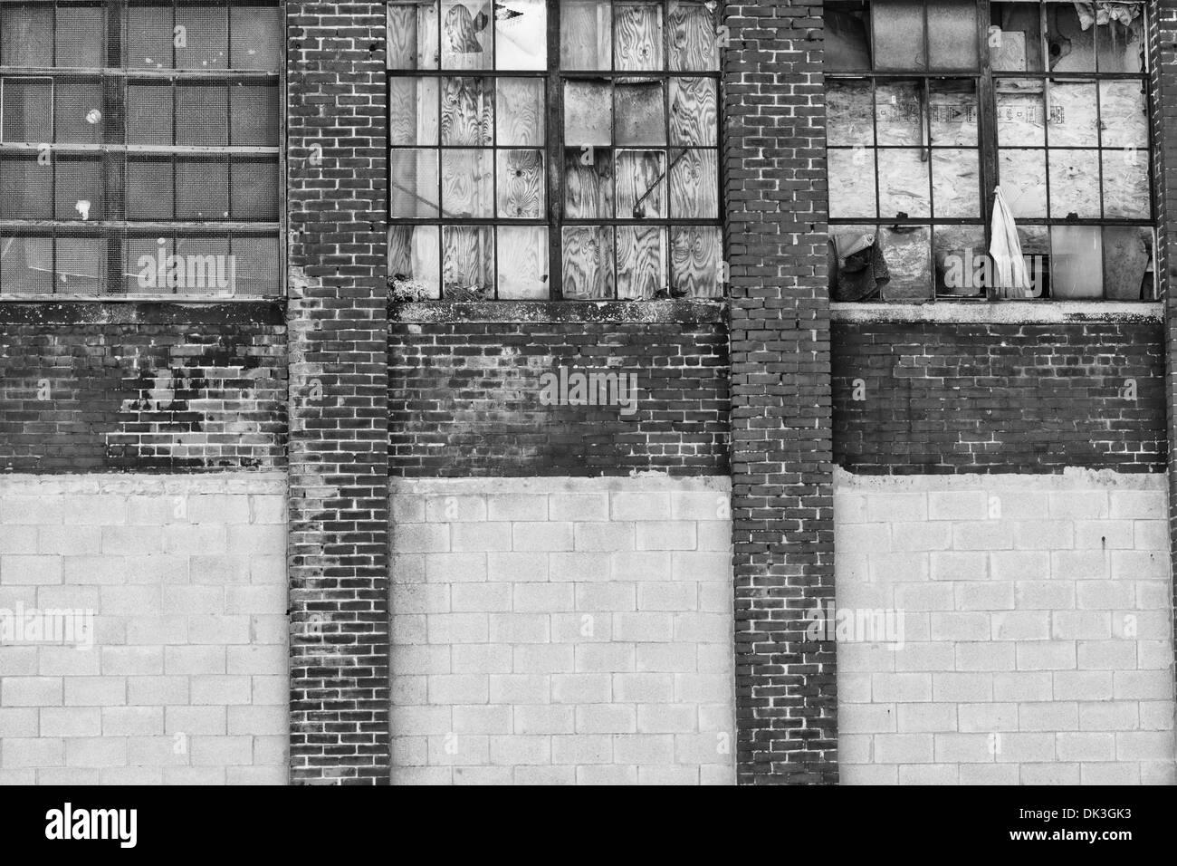 Urban Automotive Blight VIII - Abandoned Automotive Factory - Worn, Broken and Forgotten - Stock Image