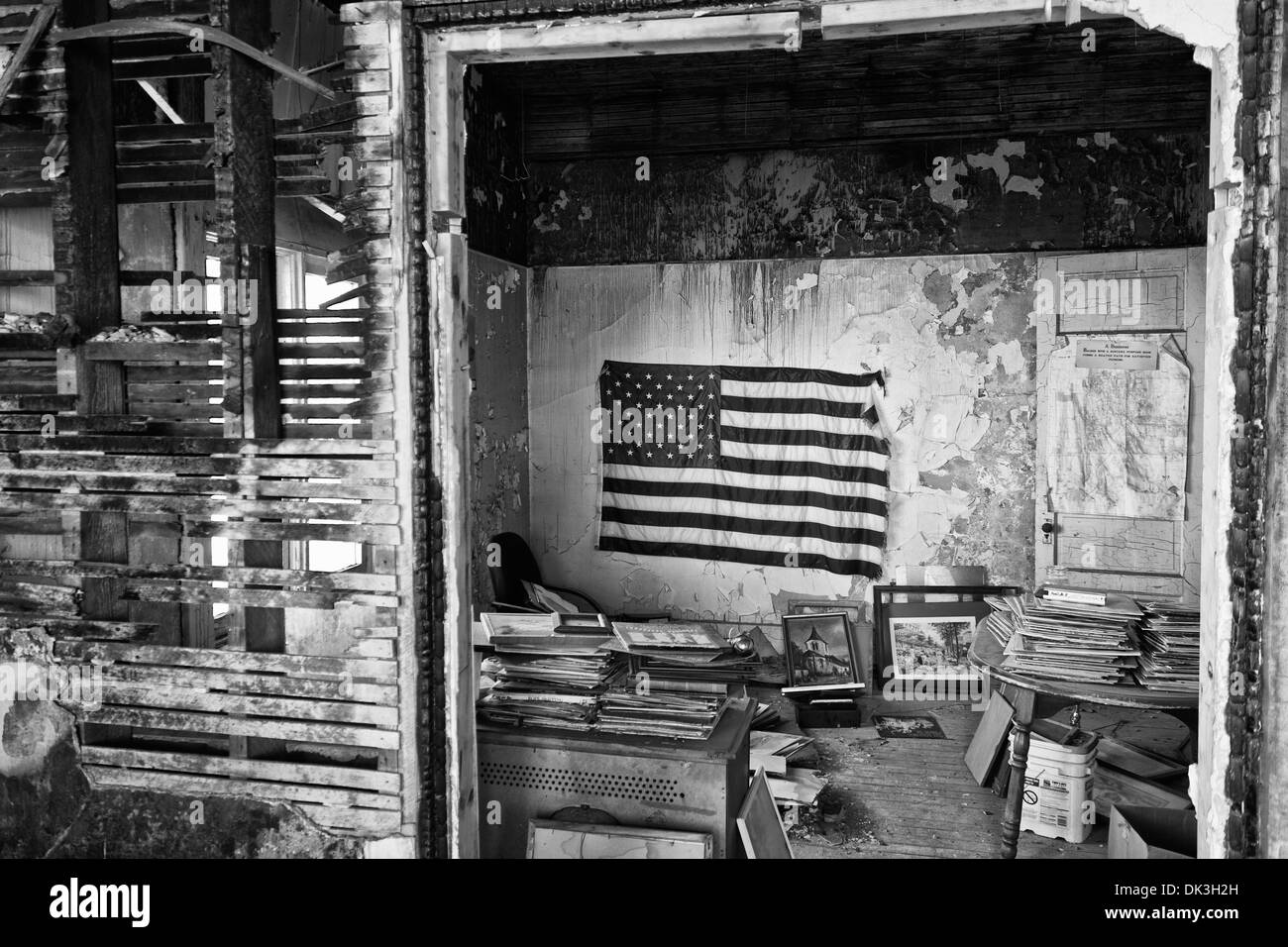 US Flag in an Abandoned Building Wide - US Flag Above the Trash in an Abandoned Apartment Slum - Stock Image
