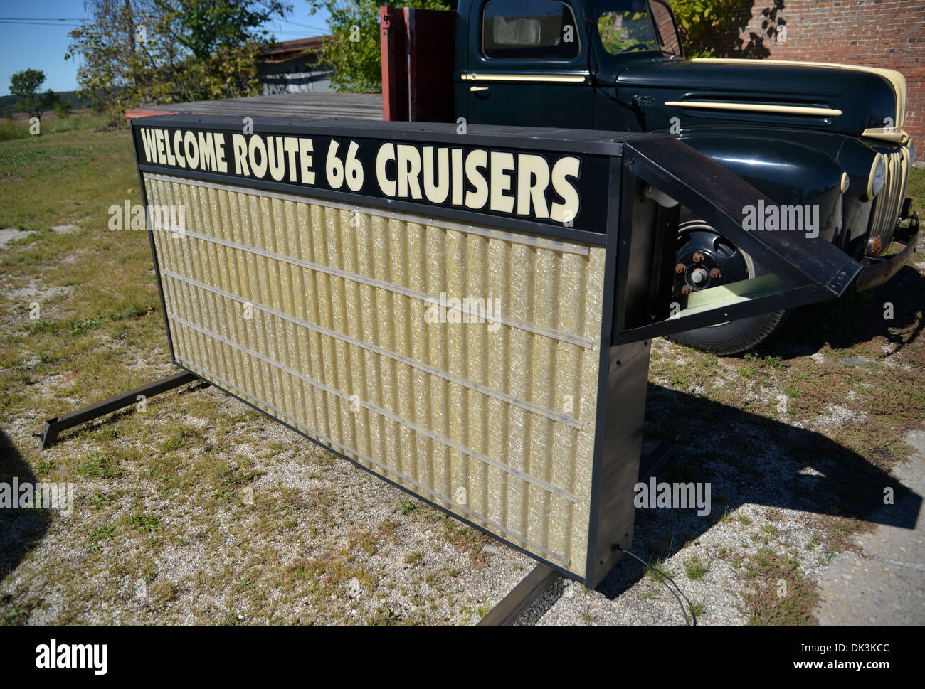 old light up 'Welcome Route 66 Cruisers' road side sign in Galena, Kansas with vintage truck - Stock Image