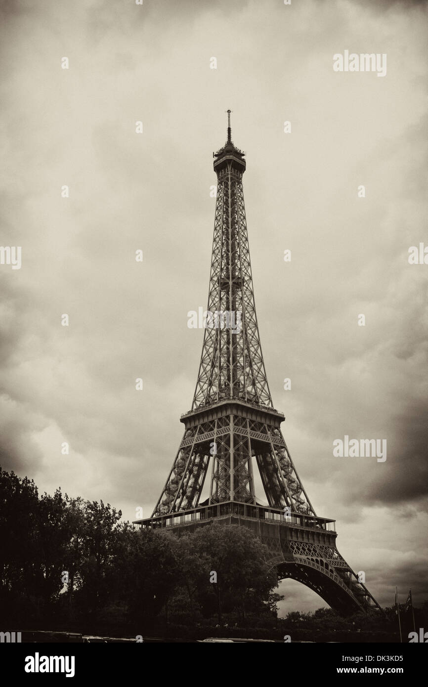 Paris Eiffel Tower - Antiqued Paris Eiffel Tower on a Cloudy Day - Stock Image