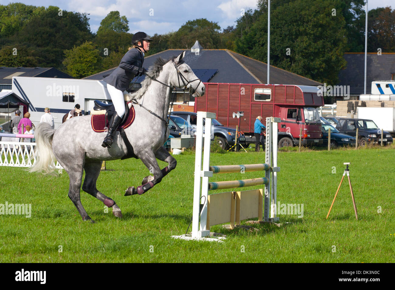 Horse Jumping eventing cross country equine sport jump show rural farm box gray gymkhana Godshill Isle of Wight - Stock Image