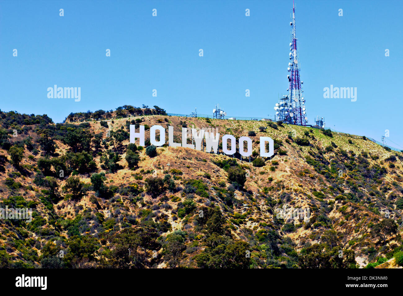 Hollywood Sign - The Hollywood Sign with Blue Sky and Tower Above - Stock Image