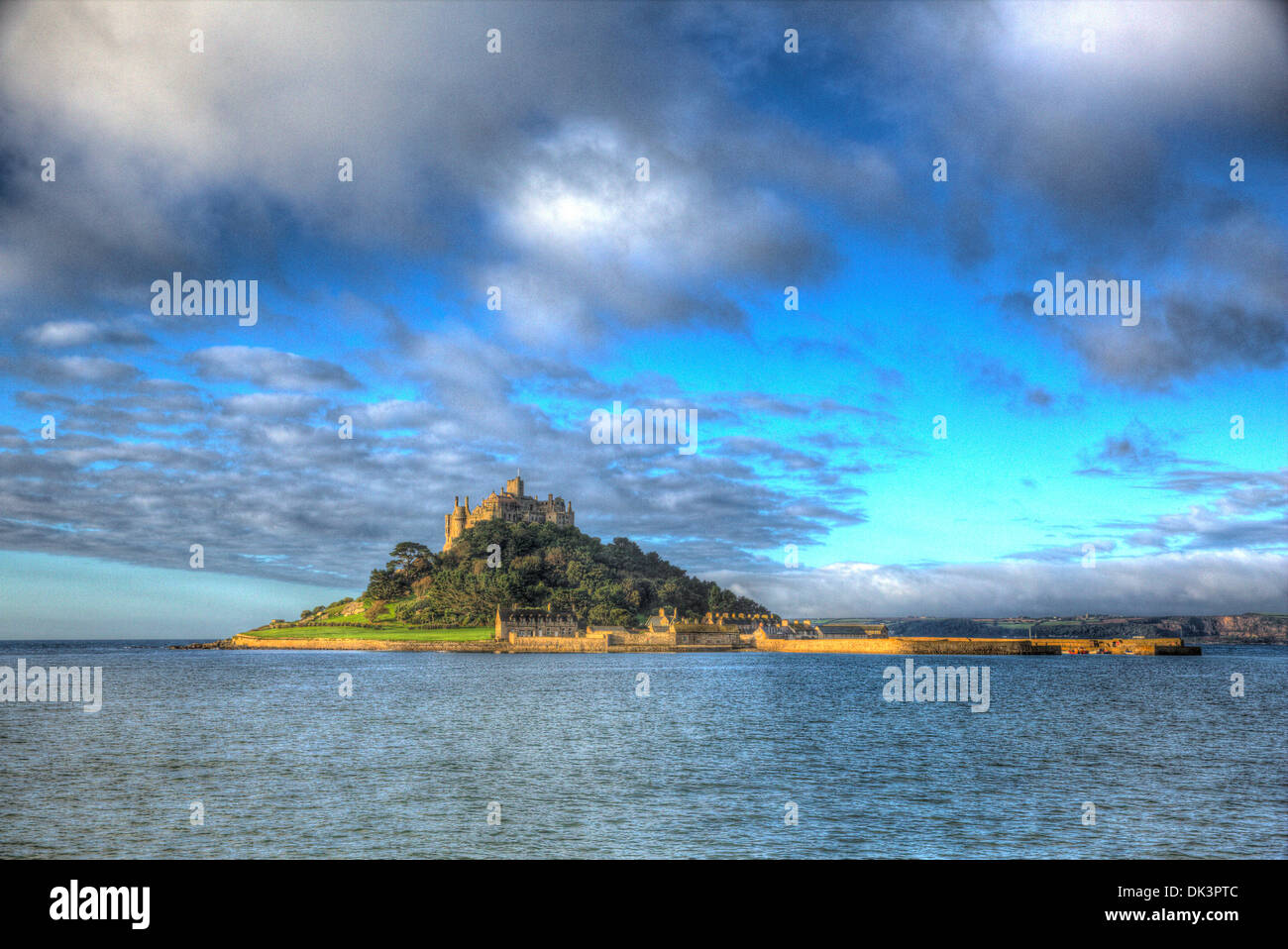 Medieval castle on island St Michaels Mount Cornwall England with vivid Cloudscape in HDR like painting Stock Photo