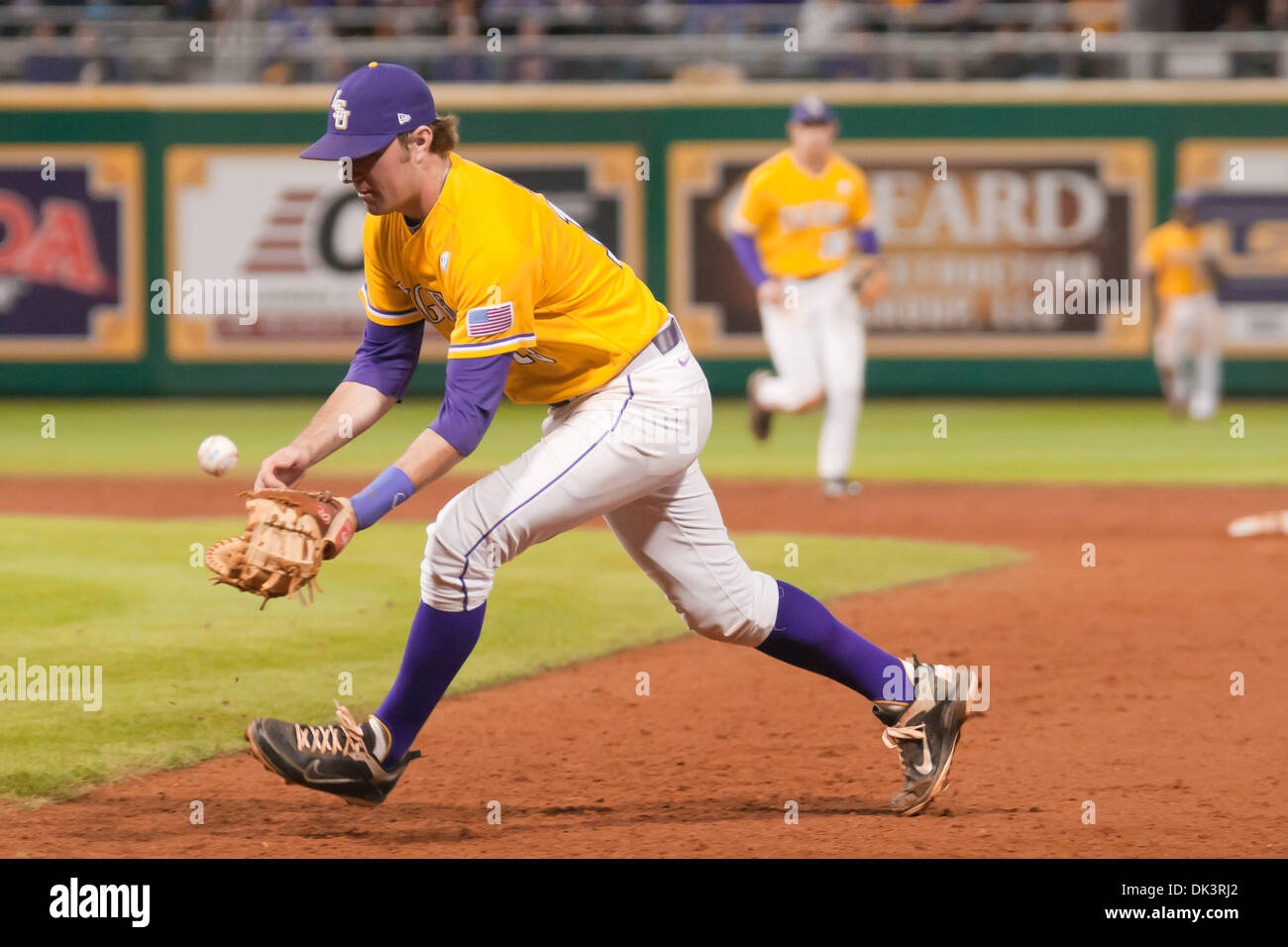 Mar. 11, 2011 - Baton Rouge, Louisiana, United States of America - LSU Tiger first baseman Alex Edward (13) contains a tricky grounder early in the game. LSU defeated Cal State Fullerton 7-6. (Credit Image: © Joseph Bellamy/Southcreek Global/ZUMAPRESS.com) - Stock Image