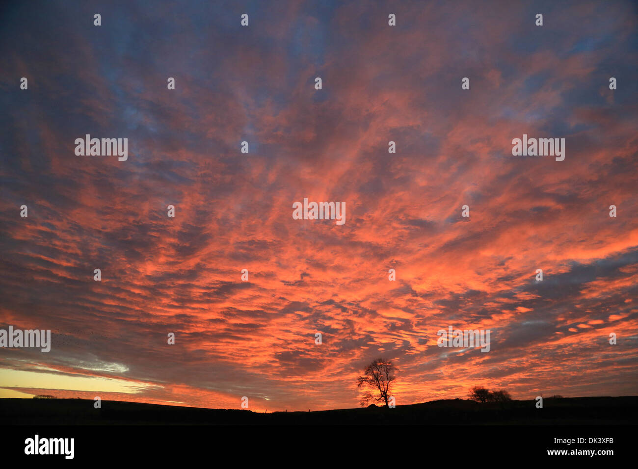 30th November 2013, With colder weather forecast clouds gather at sundown near Eyam in the Derbyshire Peak District. - Stock Image