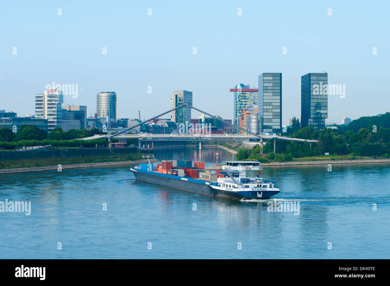 dutch container ship entering the media harbor in dusseldorf, germany Stock Photo